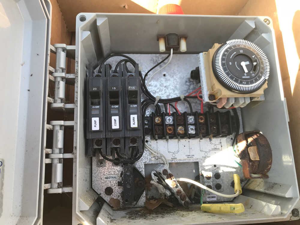 Wiring burned up in a control panel by A&M Septic